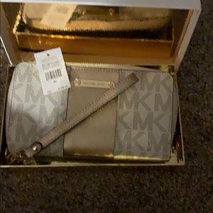 Michael Kors gold stripe phone case wristlet